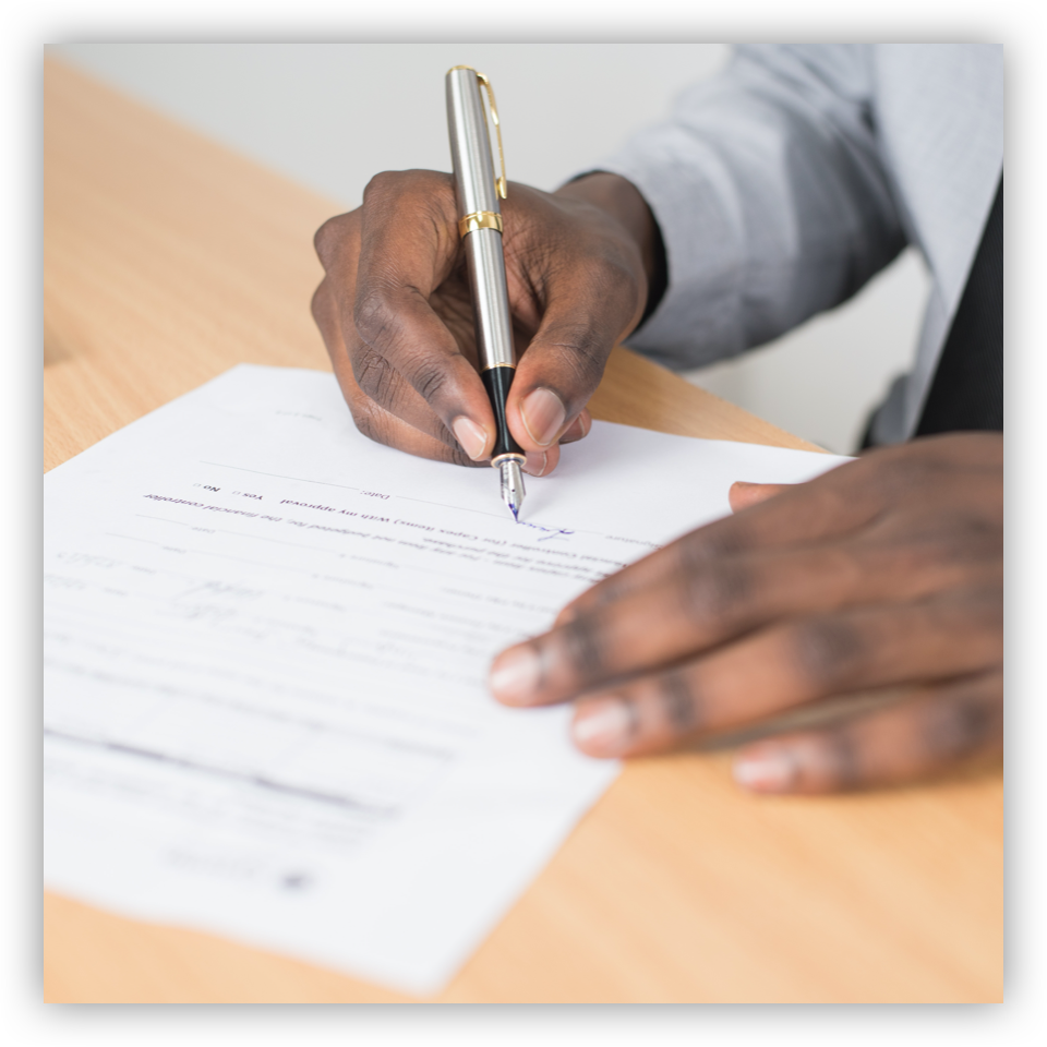 man signing contract with pen